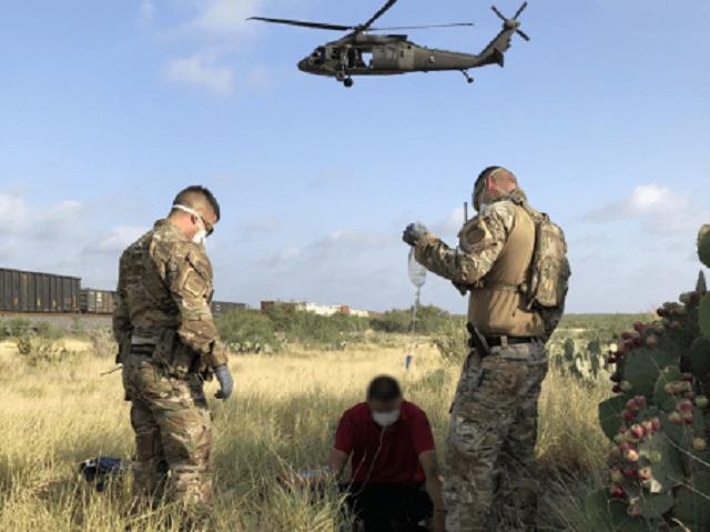Border Patrol agents and a CBP AMO aircrew rescue a lost migrant near the Texas/Mexico border. (Photo: U.S. Border Patrol/Laredo Sector)