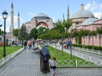 People walk in front of Hagia Sophia on July 11, 2020 in Istanbul, a day after a top Turkish court revoked the sixth-century Hagia Sophia's status as a museum, clearing the way for it to be turned back into a mosque. - The World Council of Churches, which represents 350 …