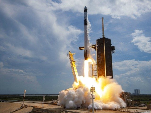 CAPE CANAVERAL, FLORIDA - MAY 30: In this SpaceX handout image, a Falcon 9 rocket carrying the company's Crew Dragon spacecraft launches on the Demo-2 mission to the International Space Station with NASA astronauts Robert Behnken and Douglas Hurley onboard at Launch Complex 39A May 30, 2020, at the Kennedy …