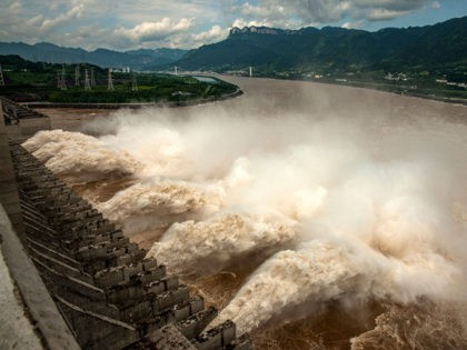 This photo taken on July 19, 2020 shows water being released from the Three Gorges Dam, a gigantic hydropower project on the Yangtze river, to relieve flood pressure in Yichang, central China's Hubei province. - Rising waters across central and eastern China have left over 140 people dead or missing, …