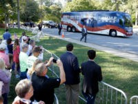 Supporters take photos as a bus carrying Republican vice presidential candidate, Indiana Gov. Mike Pence arrives at a campaign event at Catawba College in Salisbury, N.C., Monday, Oct. 24, 2016. (AP Photo/Chuck Burton)