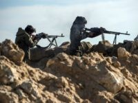 Fighters with the US-backed Syrian Democratic Forces (SDF) keep a position during an operation to expel Islamic State group (IS) jihadists from the Baghouz area in the eastern Syrian province of Deir Ezzor on February 13, 2019. - Syrian fighters backed by artillery fire from a US-led coalition battled a …