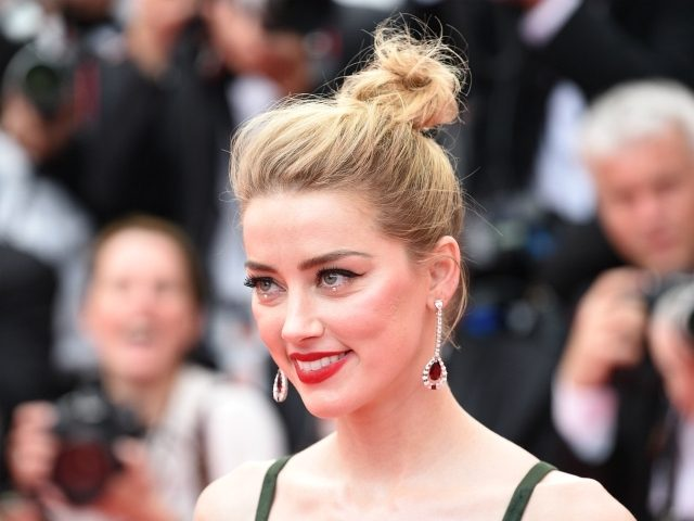 """CANNES, FRANCE - MAY 10: Amber Heard attends the screening of """"Sorry Angel (Plaire, Aimer Et Courir Vite)"""" during the 71st annual Cannes Film Festival at Palais des Festivals on May 10, 2018 in Cannes, France. (Photo by Nicholas Hunt/Getty Images)"""