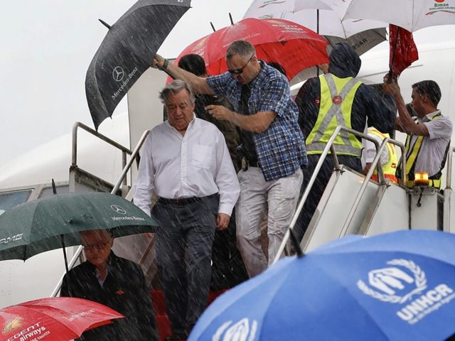 UN Secretary-General Antonio Guterres (C, white shirt) arrives in Cox's Bazar on July 2, 2018, on a visit to meet with Rohingya refugees who are living in camps near the Bangladesh-Myanmar border. - UN Secretary-General Antonio Guterres is visiting Bangladesh to assess needs for dealing with hundreds of thousands of …