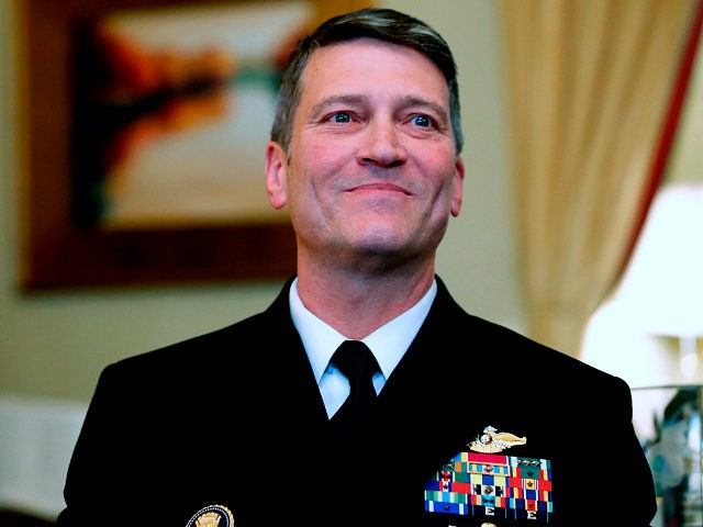 FILE - In this April 16, 2018, file photo, U.S. Navy Rear Adm. Ronny Jackson, M.D., sits before a meeting on Capitol Hill in Washington. Jackson, who abandoned his nomination to be secretary of Veterans Affairs amid numerous allegations, will not return to the job of President Donald Trump's personal …