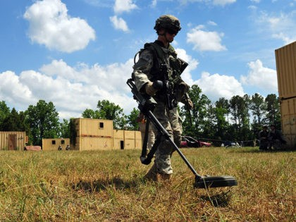 Paratroopers assigned to Company C, 2-501 PIR, 1st Brigade Combat Team, 82nd Airborne Division participate in a company attack training lane, June 24, at Fort Pickett, Va., during eXportable Combat Training Capability Rotation 14-01. (U.S. Army photo by Sgt. Juan F. Jimenez)