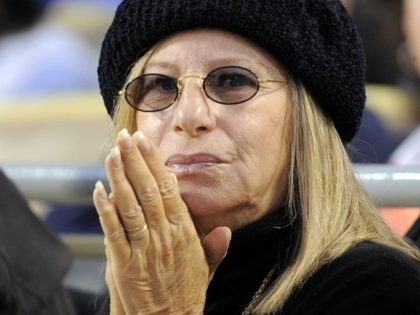 Entertainer Barbara Streisand watches the Los Angeles Dodgers play the Philadelphia Phillies during Game 4 of the National League baseball championship series Monday, Oct. 13, 2008, in Los Angeles. (AP Photo/Mark J. Terrill)