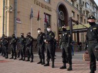 Riot police officers block an area as people gather outside the election commission headquarters to file their complaints over the electoral body's refusal to register Viktor Babaryko as a candidate for the presidential election in August, Minsk, July 15, 2020. (Photo by Sergei GAPON / AFP) (Photo by SERGEI GAPON/AFP …
