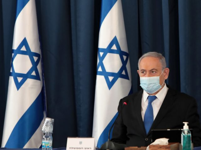 Israeli Prime Minister Benjamin Netanyahu wears a protective mask as he opens the weekly cabinet meeting at the foreign ministry in Jerusalem on July 5, 2020. (Photo by GALI TIBBON / POOL / AFP) (Photo by GALI TIBBON/POOL/AFP via Getty Images)