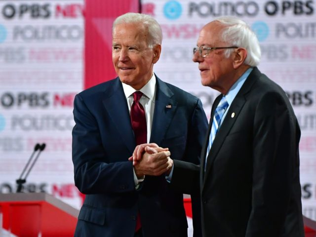 Democratic presidential hopefuls former Vice President Joe Biden (L) and Vermont Senator Bernie Sanders shake hands as they arrive to participate in the sixth Democratic primary debate of the 2020 presidential campaign season co-hosted by PBS NewsHour & Politico at Loyola Marymount University in Los Angeles, California on December 19, …