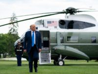 President Donald J. Trump disembarks Marine One on the South Lawn of the White House Saturday, July 11, 2020, upon his return from visiting wounded warriors, COVID-19 responders and staff at the Walter Reed National Military Medical Center in Bethesda, Md. (Official White House Photo by Tia Dufour)