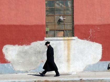 Orthodox Jewish man walks in Brooklyn.