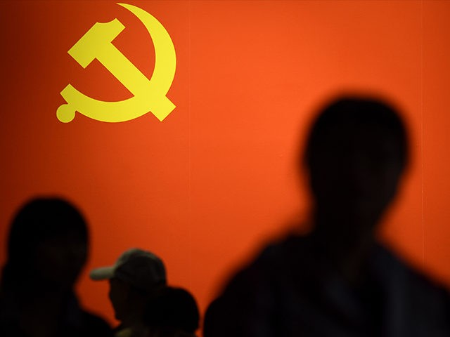 TOPSHOT - This picture taken on October 10, 2017 shows a party flag of the Chinese Communist Party displayed at an exhibition showcasing China's progress in the past five years at the Beijing Exhibition Center. China's police and censorship organs have kicked into high gear to ensure that the party's …