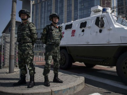 "Paramilitary police officers secure the entrance of the Belt and Road Forum venue in Beijing on April 26, 2019. - Chinese President Xi Jinping sought to bat away concerns about his ambitious Belt and Road Initiative, saying his global infrastructure project will have ""zero tolerance"" for corruption while vowing to …"