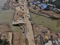 This photo taken on July 23, 2016 shows a bridge damaged by recent floodwaters in Daxian village in Xingtai, north China's Hebei province. As of July 25, morning more than half a million people in the hardest-hit provinces of Henan and Hebei had been displaced, with 125,000 people in urgent …
