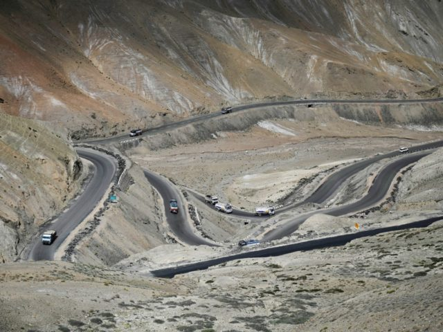Fuel tankers are pictured on the Ladakh highway between Kargil and Leh on June 21, 2020. - India and China agreed on June 17 to ease tensions at their disputed Himalayan border, even as they traded blame for a brawl that left at least 20 Indian soldiers dead. The two …
