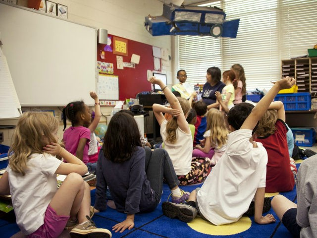 Classroom with students with hands raised