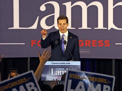 FILE - In this March 14, 2018 file photo, Conor Lamb, the Democratic candidate for the March 13 special election in Pennsylvania's 18th Congressional District celebrates with his supporters at his election night party in Canonsburg, Pa. A longtime congressional stronghold for Republicans, Pennsylvania is emerging in dramatic fashion as …