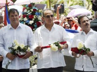 "(L-R) Ramon Labanino, Antonio Guerrero and Fernando Gonzalez, three of the ""Cuban Five"" intelligence agents arrested in Miami in 1998 and convicted of espionage, talk at the end of a ceremony in Caracas on May 4, 2015. The Cuban spies whose release by the United States helped pave the way …"