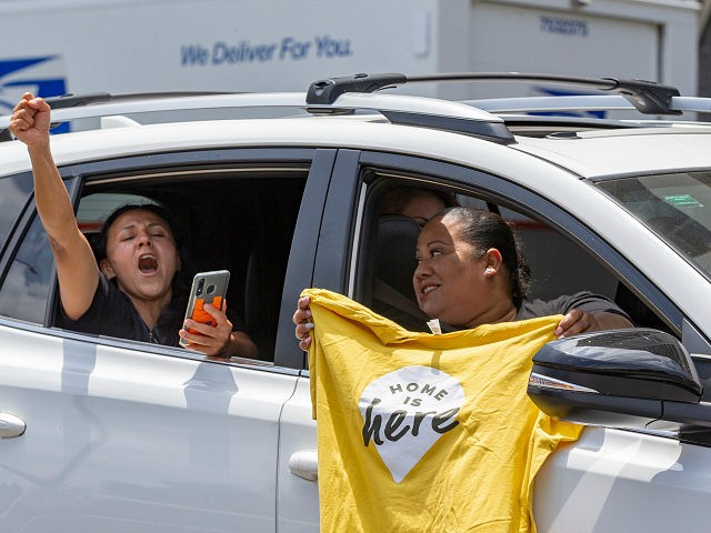 Immigrant families cheer during a caravan to rally for the Deferred Action for Childhood Arrivals Program (DACA), around MacArthur Park in Los Angeles, Thursday, June 18, 2020, after the Supreme Court rejected President Donald Trump's effort to end legal protections for 650,000 young immigrants. (AP Photo/Damian Dovarganes)