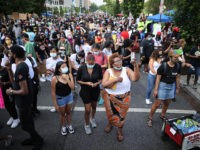 WASHINGTON, DC - JUNE 19: People fill 16th Street north of the White House, now called Black Lives Matter Plaza, while celebrating the Juneteenth holiday June 19, 2020 in Washington, DC. Juneteenth commemorates June 19, 1865, when a Union general read orders in Galveston, Texas stating all enslaved people in …