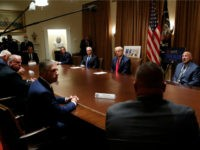 President Donald Trump listens during a meeting with leaders of some of the national law enforcement organizations in the Cabinet Room of the White House, Friday, July 31, 2020, in Washington. (AP Photo/Alex Brandon)