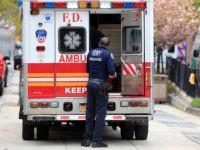 NEW YORK, NY - APRIL 23: A FDNY paramedic unloads a patient from an ambulance near the Emergency Room entrance to the Brooklyn Hospital Center on April 23, 2020 in the Clinton Hill neighborhood of the Brooklyn borough of New York City. New York City remains the epicenter of the …