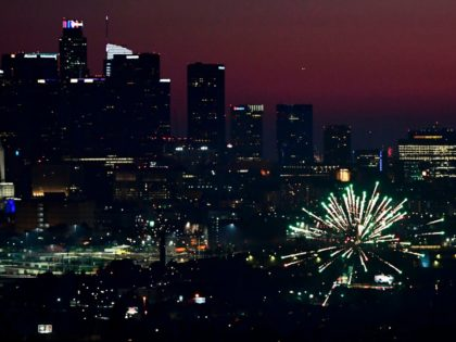 Fireworks erupt near downtown Los Angeles, California on July 4, 2020 during celebrations for the Fourth of July holiday, amid the coronavirus pandemic. (Photo by Frederic J. BROWN / AFP) (Photo by FREDERIC J. BROWN/AFP via Getty Images)