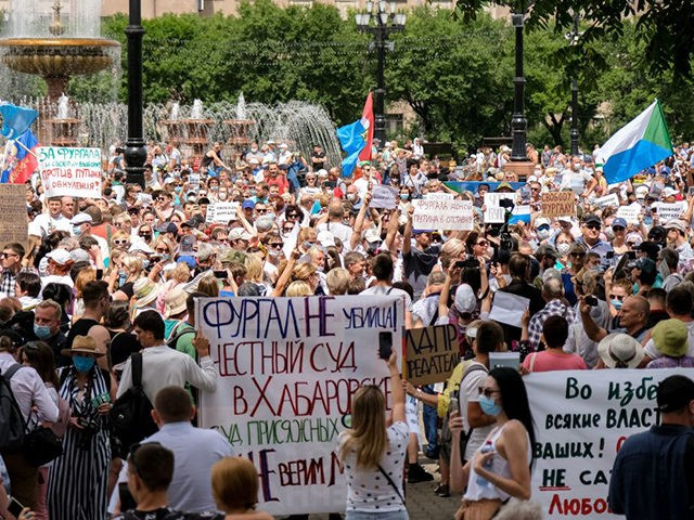 People hold banners and signs during an unauthorised rally in support of Sergei Furgal, the governor of the Khabarovsk region who was arrested, in the Russian far eastern city of Khabarovsk on July 25, 2020. - Huge anti-government demonstrations erupted in Russia's Far East on July 25 over the arrest …