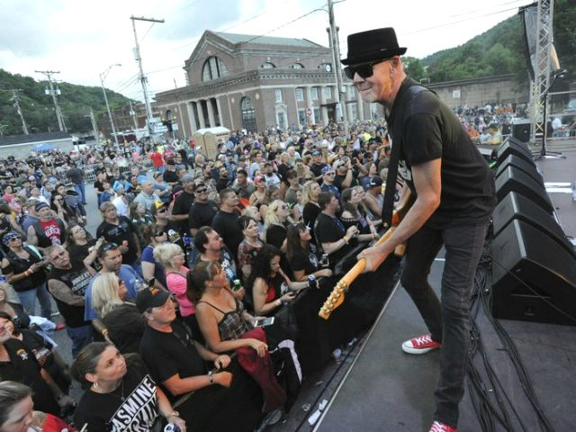 FILE - In this June 23, 2018, file photo, Mark Kendall, center, with the band Great White, performs on the Train Station stage during the 21st Annual Thunder in the Valley motorcycle rally in Johnstown, Pa. Metal band Great White has apologized for performing at an outdoor North Dakota concert …
