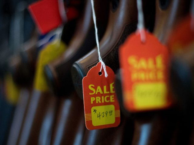 A sale tag hangs from a rifle at the Lynchburg Arms & Indoor Shooting Range in Lynchburg, Virginia, on October 20, 2017. - Virginia residents go to the polls on November 7 to vote for governor and members of the state's legislature. Following a mass shooting in Las Vegas that …