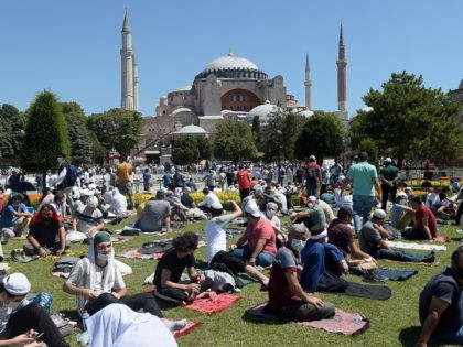 Faithful wait at the historic Sultanahmet district of Istanbul, outside the Byzantine-era Hagia Sophia, Friday, July 24, 2020. Hundreds of Muslim faithful were making their way to Istanbul's landmark monument Friday to take part in the first prayers in 86 years at the structure that was once Christendom's most significant …