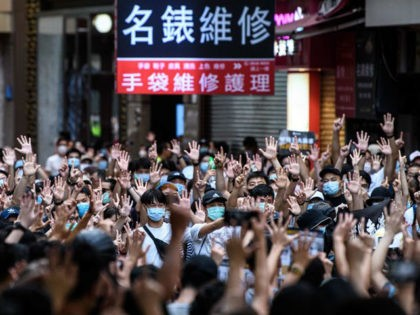 TOPSHOT - Protesters chant slogans and gesture during a rally against a new national security law in Hong Kong on July 1, 2020, on the 23rd anniversary of the city's handover from Britain to China. - Hong Kong police arrested more than 300 people on July 1 -- including nine …