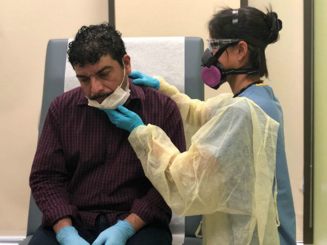 Guatemalan immigrant Marvin is checked by a physician's assistant before receiving a COVID-19 swab test at a clinic on May 5, 2020 in Stamford, Connecticut. Marvin and his son Junior were re-tested to see if they are now are negative, a month after getting sick from coronavirus. Marvin's wife Zully, …