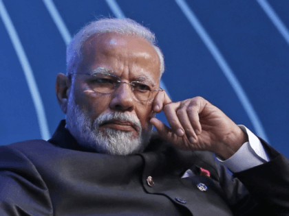 In this Nov. 13, 2019, file photo, Indian Prime Minister Narendra Modi attends the BRICS Business Council prior to the 11th edition of the BRICS Summit, in Brasilia, Brazil. From industrialists and foreign companies to celebrities and ordinary citizens, people from all walks of life pitched in for a newly …