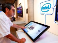 A visitor interacts with a display by Intel, at a technology exhibit at the Peres Center for Peace and Innovation in the Israeli coastal city of Tel Aviv on September 3, 2019. - The Peres Centre for Peace and Innovation serves in part as a shrine to Israel's long list …