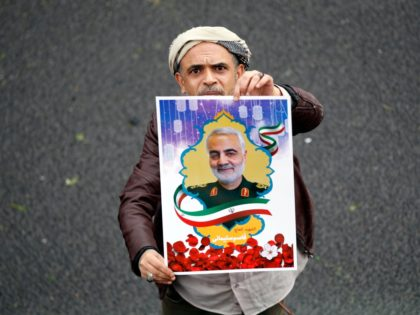 A Yemeni supporter of the Huthi movement holds a poster of slain Iranian major general Qassem Soleimani during a demonstration in Sanaa on January 6, 2020 to denounce the US killing of the top Iranian general and Iraqi paramilitary chief Abu Mahdi al-Muhandis. - Soleimani and al-Muhandis were killed in …