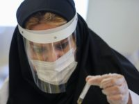 TOPSHOT - An Iranian doctor works on the production of COVID-19 test kits at a medical center in Karaj, in the northern Alborz Province, on April 11, 2020. - Iran reported 125 new deaths from the novel coronavirus, raising the overall toll in the Middle East's worst-hit country to 4,357. …