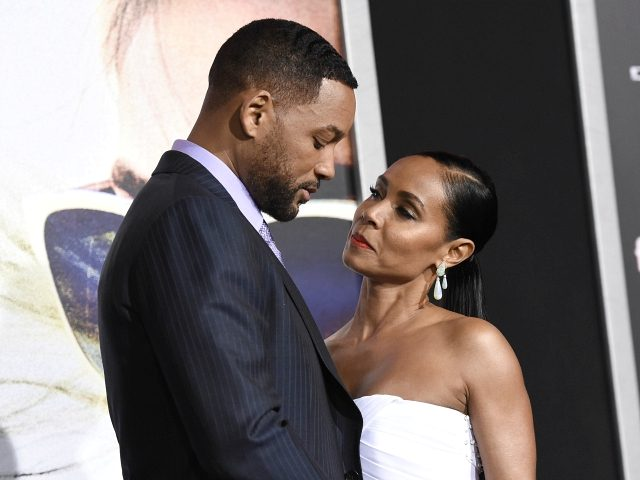 "Will Smith, left, and Jada Pinkett Smith arrive at the world premiere of ""Focus"" at the TCL Chinese Theatre on Tuesday, Feb. 24, 2015, in Los Angeles. (Photo by Chris Pizzello/Invision/AP)"