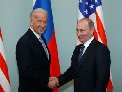 Vice President of the United States Joe Biden, left, shakes hands with Russian Prime Minister Vladimir Putin in Moscow, Russia, Thursday, March 10, 2011. The talks in Moscow are expected to focus on missile defense cooperation and Russia's efforts to join the World Trade Organization. (AP Photo/Alexander Zemlianichenko)