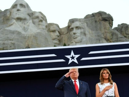 US President Donald Trump and First Lady Melania Trump pay their respects as they listen to the National Anthem during the Independence Day events at Mount Rushmore National Memorial in Keystone, South Dakota, July 3, 2020. (Photo by SAUL LOEB / AFP) (Photo by SAUL LOEB/AFP via Getty Images)