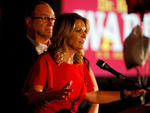 SCOTTSDALE, AZ - AUGUST 28: Arizona GOP senate candidate Kelli Ward, with husband Michael Ward by her side, concedes the primary in a speech to supporters at an election night event on August 28, 2018 in Scottsdale, Arizona. Former state Sen. Ward, U.S. Rep. Martha McSally and former Maricopa County …