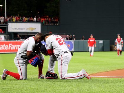 BALTIMORE, MARYLAND - JULY 17: Victor Robles #16 and Juan Soto #22 of the Washington Nationals kneel before the start of the Washington Nationals and Baltimore Orioles game at Oriole Park at Camden Yards on July 17, 2019 in Baltimore, Maryland. (Photo by Rob Carr/Getty Images)