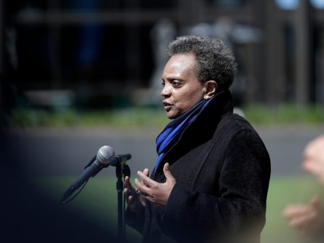 Chicago Mayor Lori Lightfoot speaks at a news conference in front of Wrigley Field in Chicago, Thursday, April 16, 2020. The Chicago Cubs are coordinating with Lakeview Pantry to utilize the field's concourse as a satellite food packing and distribution center to support COVID-19 relief efforts. (AP Photo/Nam Y. Huh)