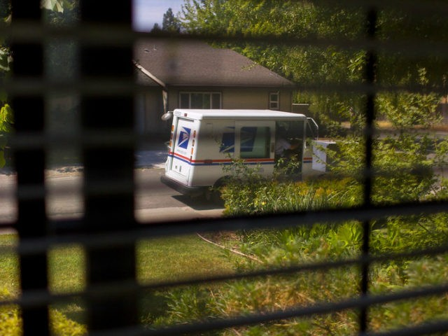 Postal truck and mailman seen through house blinds