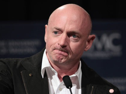 TUCSON, AZ - JANUARY 20: Mark Kelly, husband of U.S. Rep. Gabrielle Giffords (D-AZ), speaks to reporters at the University Medical Center on January 20, 2011 in Tucson, Arizona. The wounded Congresswoman is to be transfered Friday from the Tuscon hospital to Houston to begin rehabilitation therapy at TIRR Memorial …