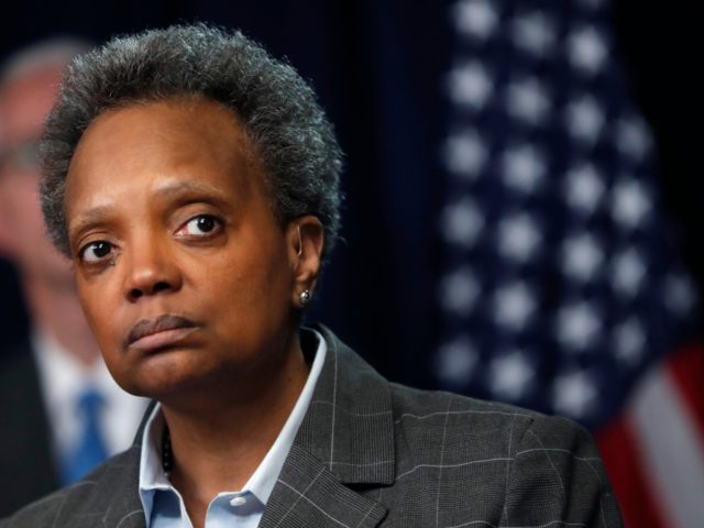 Chicago mayor Lori Lightfoot listens to a question after Illinois Gov. J.B. Pritzker announced a shelter in place order to combat the spread of the Covid-19 virus, during a news conference Friday, March 20, 2020, in Chicago. (AP Photo/Charles Rex Arbogast)