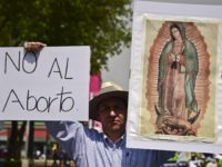 Mexican activists protest demanding the abolition of the law that allows to abort in the Mexican capital, on April 25, 2015 in Mexico City. AFP PHOTO/RONALDO SCHEMIDT (Photo credit should read RONALDO SCHEMIDT/AFP via Getty Images)