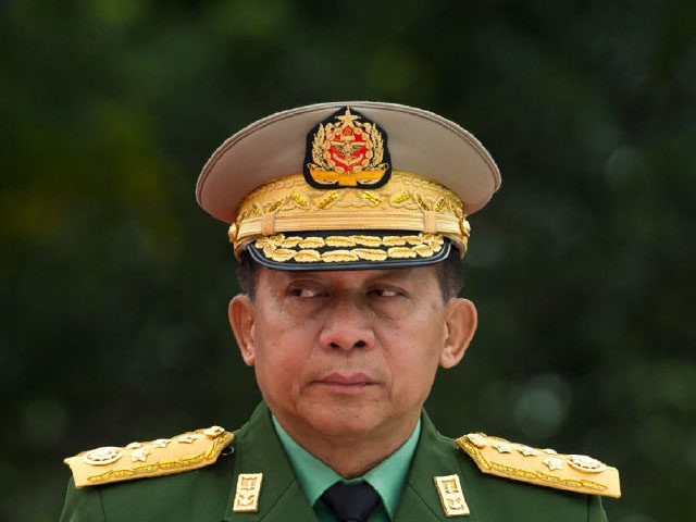 TOPSHOT - Myanmar's Chief Senior General Min Aung Hlaing, commander-in-chief of the Myanmar armed forces, arrives to pay his respects to Myanmar independence hero General Aung San and eight others assassinated in 1947, during a ceremony to mark the 71th anniversary of Martyrs' Day in Yangon on July 19, 2018. …