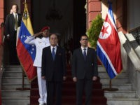 North Korea's President of the Presidium of the Supreme People's Assembly, Kim Yong Nam (2-R), poses with Venezuela's Foreign Minister Jorge Arreaza (R) at the Miraflores presidential palace, ahead of a private meeting with President Nicolas Maduro in Caracas, Venezuela on November 27, 2018. - Kim Yong Nam's visit is …